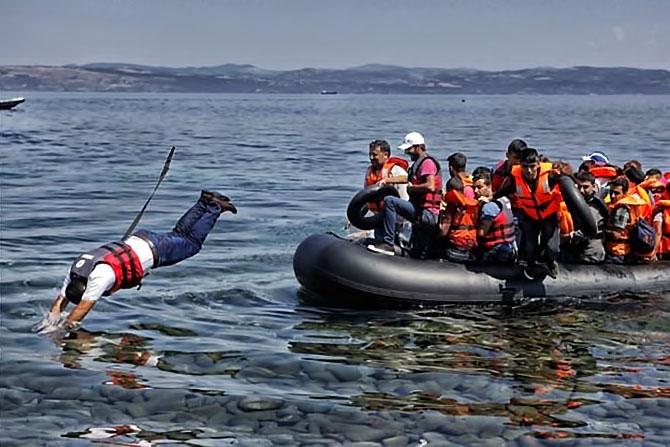 Fotoğraflarla hedefe ulaşan sığınmacıların sevinci galerisi resim 2