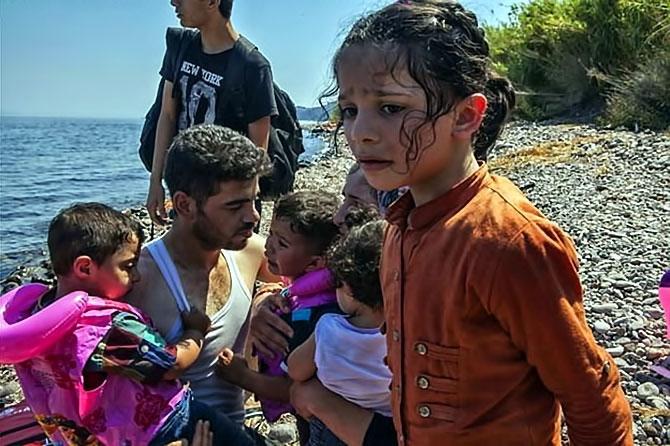 Fotoğraflarla hedefe ulaşan sığınmacıların sevinci galerisi resim 5