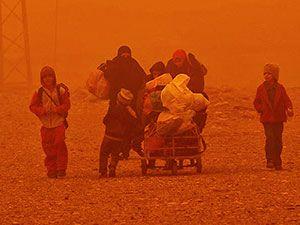 Kum fırtınasına rağmen Musul'dan kaçış
