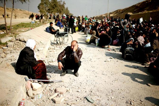 Reuters objektifinden Musul'dan kaçış galerisi resim 12