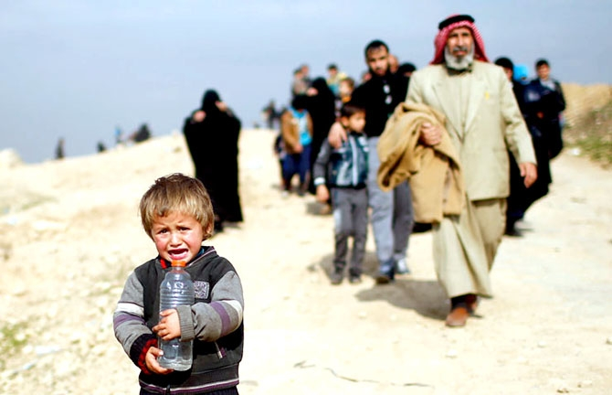 Reuters objektifinden Musul'dan kaçış galerisi resim 2
