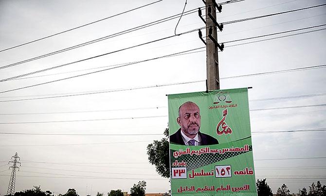 Irak Meclis adaylarının afişleri Tahran sokaklarında galerisi resim 1