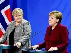 Merkel: Türkiye'den alarm sinyalleri geliyor