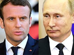 Macron Putin'i Versailles Sarayı'nda ağırlıyor