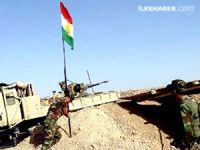 Ve Kürdistan bayrağı Zap Nehri'nin batısında